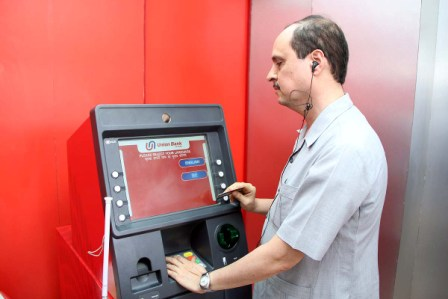 Doctor Sam Taraporevala, Director X R C V C using Talking ATM at B P A, Ahmedabad