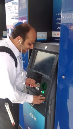 Jatin Shah, a corporate executive using CITIBANK Talking ATM placed at a Mumbai Mall
